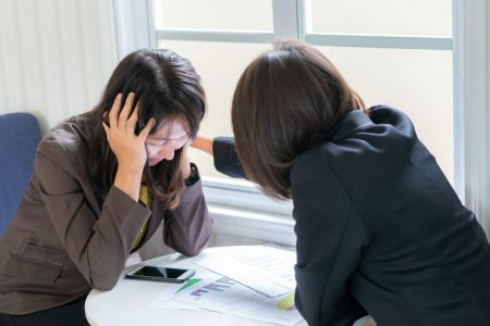Business woman consoling her friend that suffering about problem working